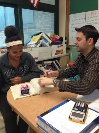SAT Tutor Nicholas Tropeano helps Sophomore Maya Dunchus with an SAT problem