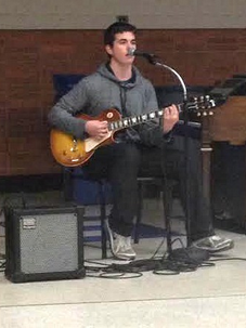"""Junior Patrick Henkels performed """"Tears          in Heaven"""" on his electric guitar. He also sang the Eric Clapton song."""