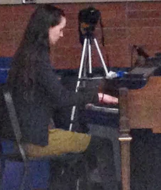 """Junior and editor of Muse, Amelia Markey performed """"Exogenesis Symphony Part II"""" on  the piano. She organized most of Open Mic Night. """"[Open Mic Night] is important because we need money for the magazine,"""" said Markey. """"This is the best type of fundraiser."""""""
