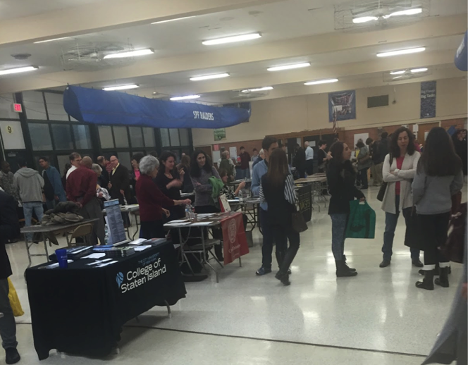photo by Haley Nakonechny Tables for multiple colleges set up in the cafeteria.  More than 150 colleges were at Scotch Plains-Fanwood High School in attendance.