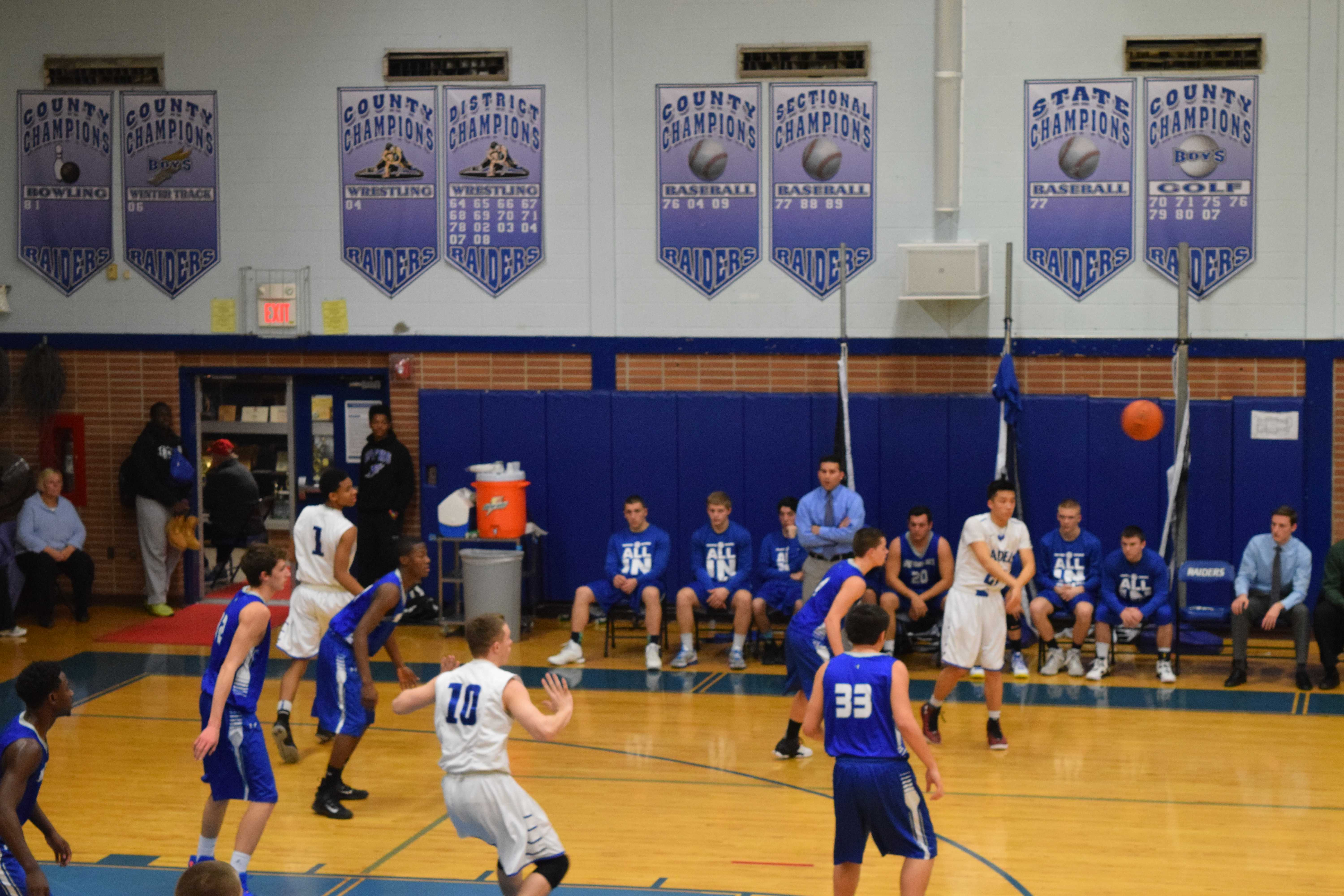 Senior Aaron Lee makes a pass. As point guard, Lee was a clear leader on the court.