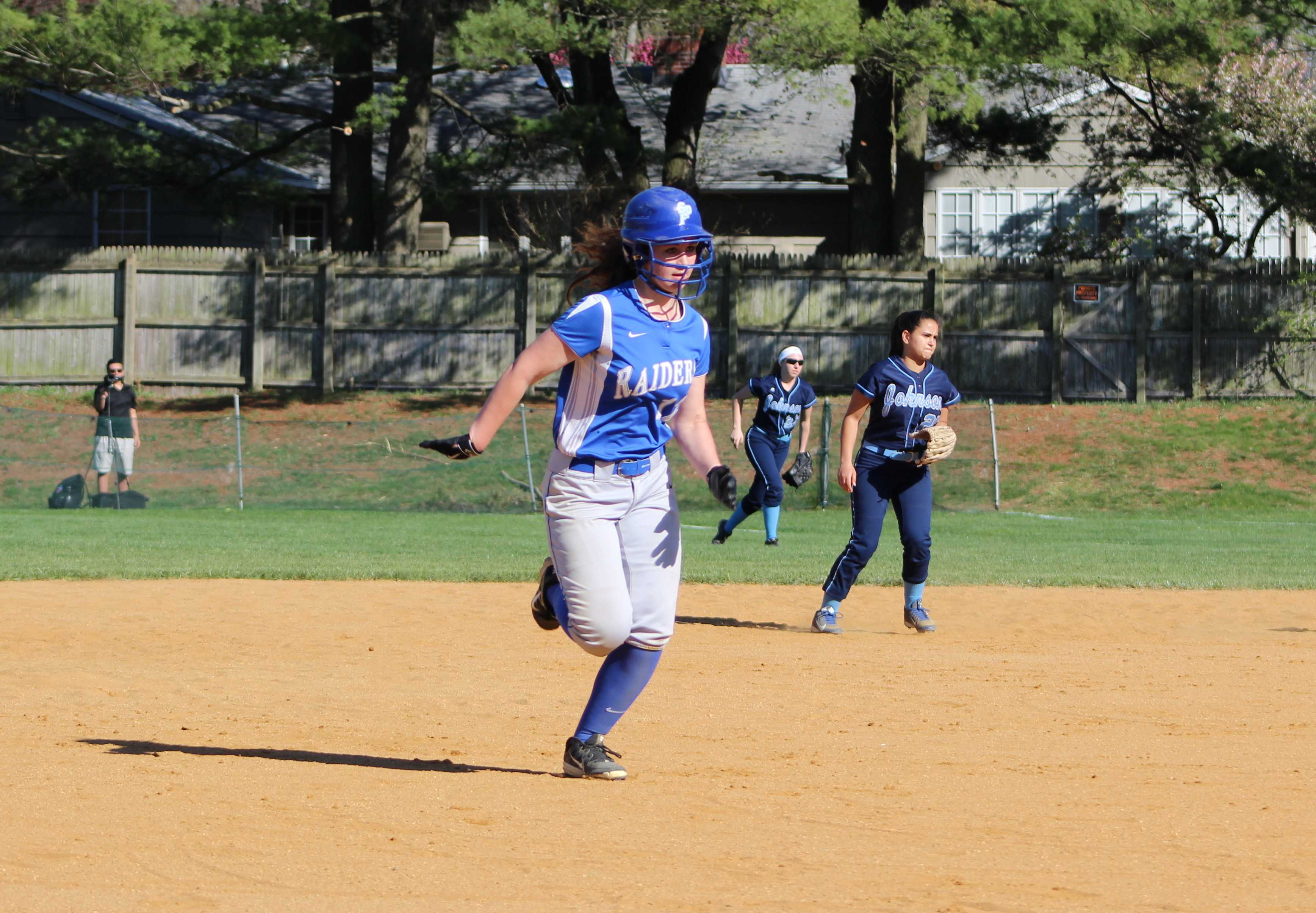 Sophomore Emily Lockatell rounds the bases.