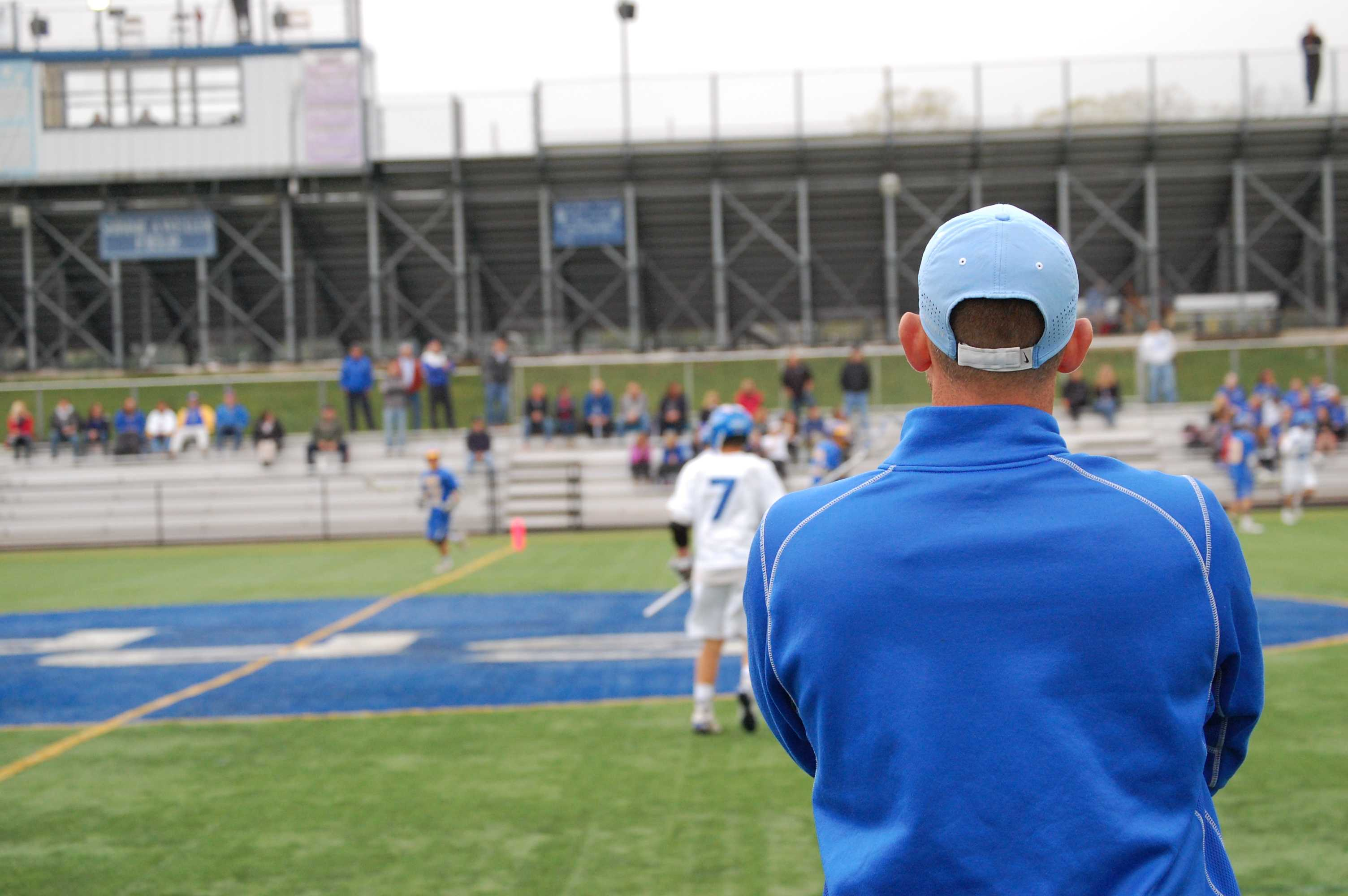 Head coach Nick Miceli looks on from the sideline.
