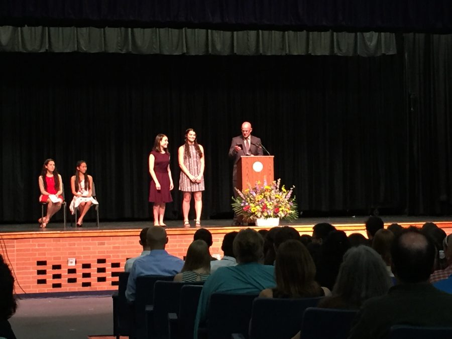 Principal David Heisey announces senior Emily Boyle as valedictorian and senior Kara Foley as salutatorian at SPFHS's senior awards night. The two students achieved the highest grade point averages out of the senior class.