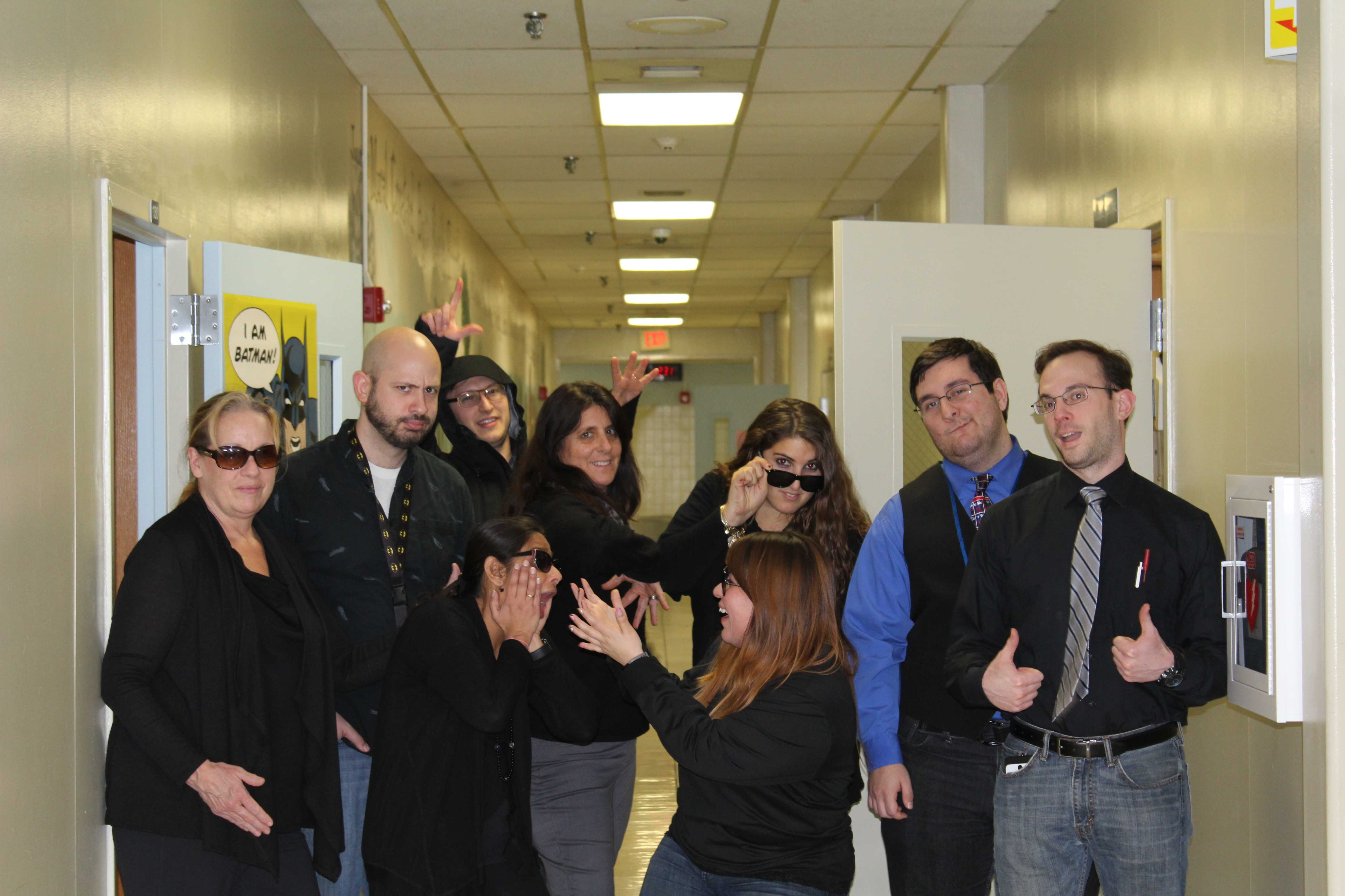 The science department poses for a silly picture in their 'Matrix'-based attire.