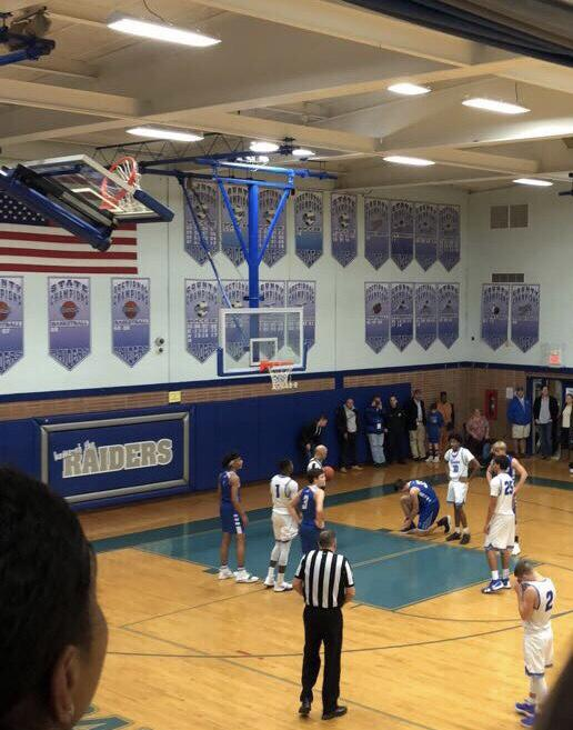 Varsity+basketball+defeats+Roselle+63-43
