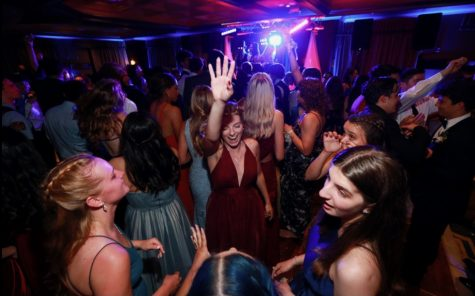 Seniors Allie Serio, Jamie Frank and others dancing at senior prom
