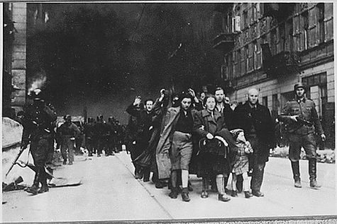 Jewish civilians march during the 1943 destruction of the Warsaw Ghetto. This event was created and organized by hundreds of women involved in the Jewish resistance.