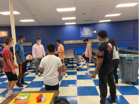 Students gather in a circle in the multi-purpose room to play jianzi(毽子) during the Mid-Autumn festival. The main value of the Mid-Autumn holiday in China is unity of friends and family which is one of the main reasons why this festival was started in the first place.