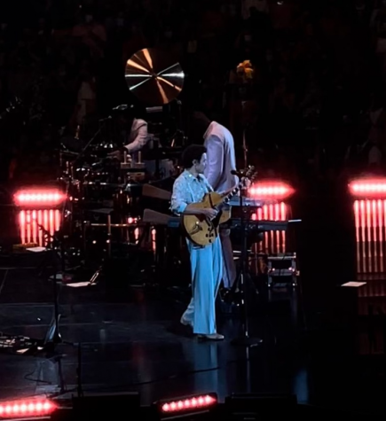 Taking the stage at the Amway Center, Harry Styles plays his electric guitar. He was beyond excited to be performing for fans down in Florida.
