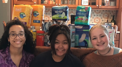 SPF Seniors Amelia Collins, Natalie Green and Rica Lopez pose in front of various Her Drive donations. The satisfaction of helping people inspired Collins, Green and Lopez to plan more donation drives in the near future.